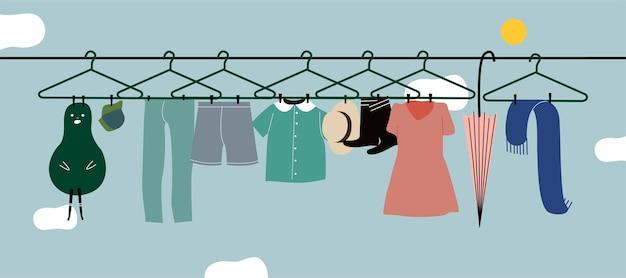 Gewassen kleding die aan de waslijn hangt Gratis Vector