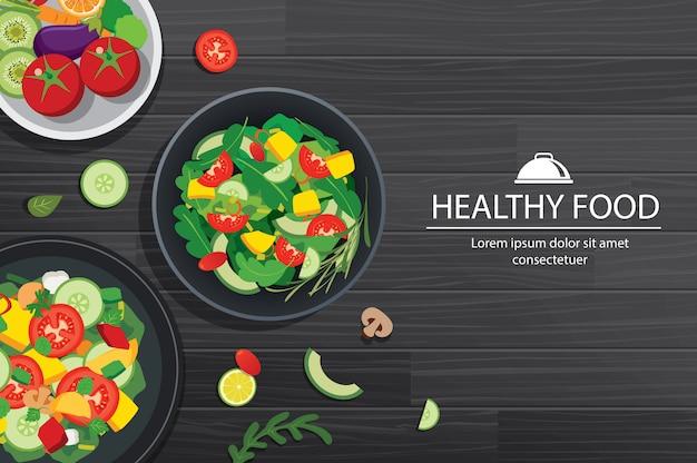 Gezond voedsel met ingrediënten op houten lijstachtergrond. Premium Vector