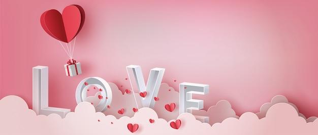 Giftdoos met hartballon en brievenliefde op wolk, gelukkige valentijnsdag. Premium Vector