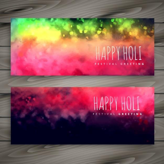 Glanzende kleurrijke holi banners Gratis Vector