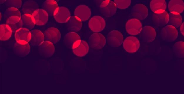 Glanzende paarse rode bokehbanner met tekstruimte Gratis Vector