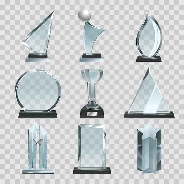 Glanzende transparante trofeeën, onderscheidingen en winnaarbekertjes. Premium Vector