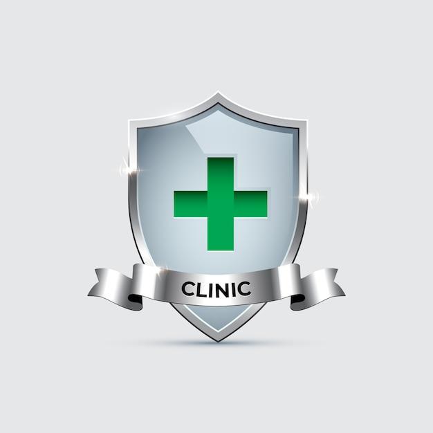 Glazen schild met zilveren frame met groen kruisteken en zilveren lint met clinic-woord. Premium Vector