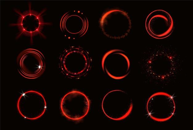 Gloed rode cirkels met glitters en rook Gratis Vector