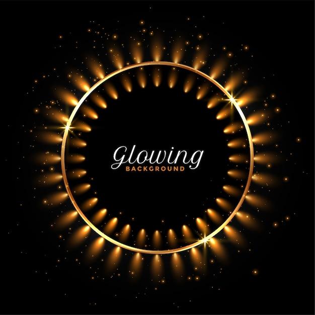 Gloeiende cirkelvormige gouden lichten op zwarte achtergrond Gratis Vector