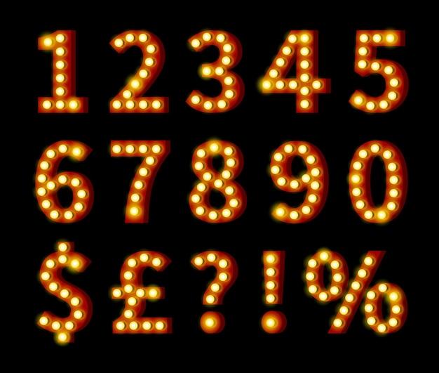 Gloeiende geeloranje cijfers en symbolen die op zwarte achtergrond worden geïsoleerd Gratis Vector
