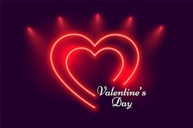 Gloeiende rode neon harten valentijnsdag wenskaart Gratis Vector