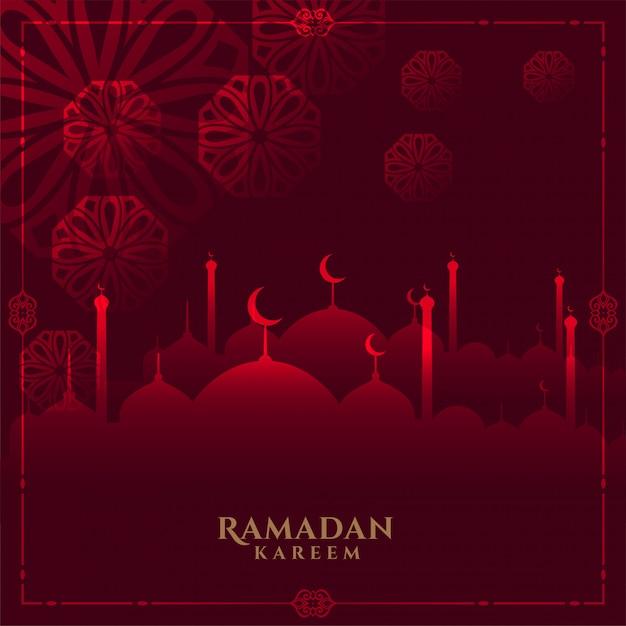 Gloeiende rode ramadan kareem achtergrond met moskee Gratis Vector