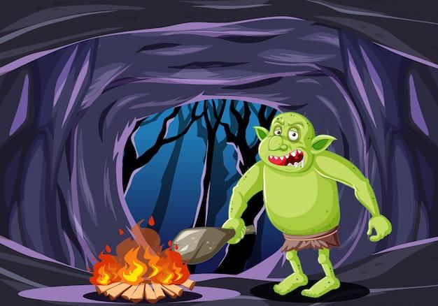 Goblin of trol met vuur cartoon stijl op donkere grot achtergrond Gratis Vector