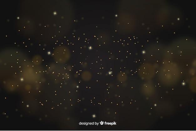Gouden achtergrond met gouden deeltjes Gratis Vector