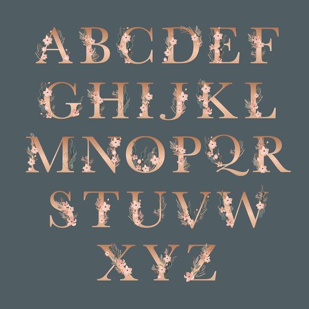 Gouden alfabet met elegante bloemen Gratis Vector