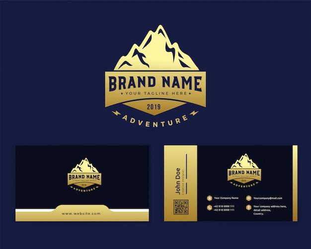 Gouden berg logo sjabloon Premium Vector