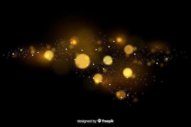 Gouden drijvend deeltjeseffect met zwarte achtergrond Gratis Vector