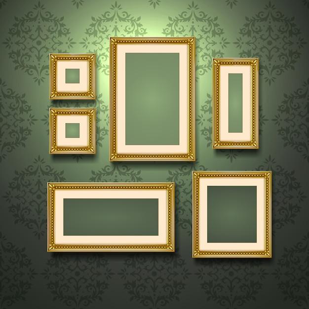 Gouden frames op de muur Gratis Vector