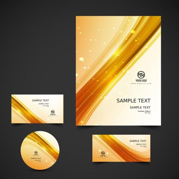 Gouden golvende zakelijke briefpapier Gratis Vector