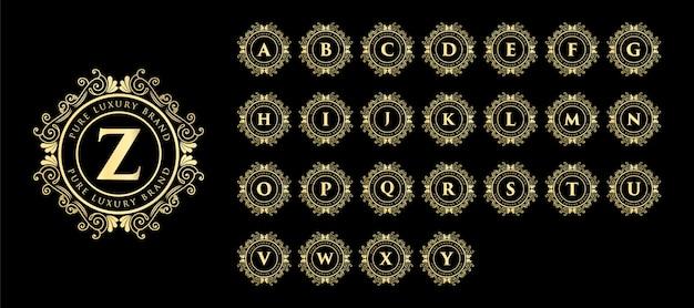 Gouden kalligrafische vrouwelijke bloemen hand getrokken monogram antieke vintage stijl luxe logo-ontwerp en decor Premium Vector