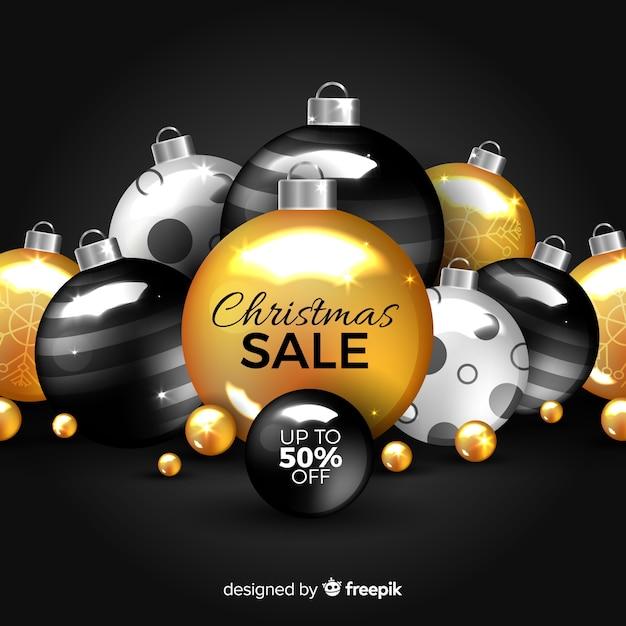 Gouden kerstmisverkoop met ornamenten Gratis Vector