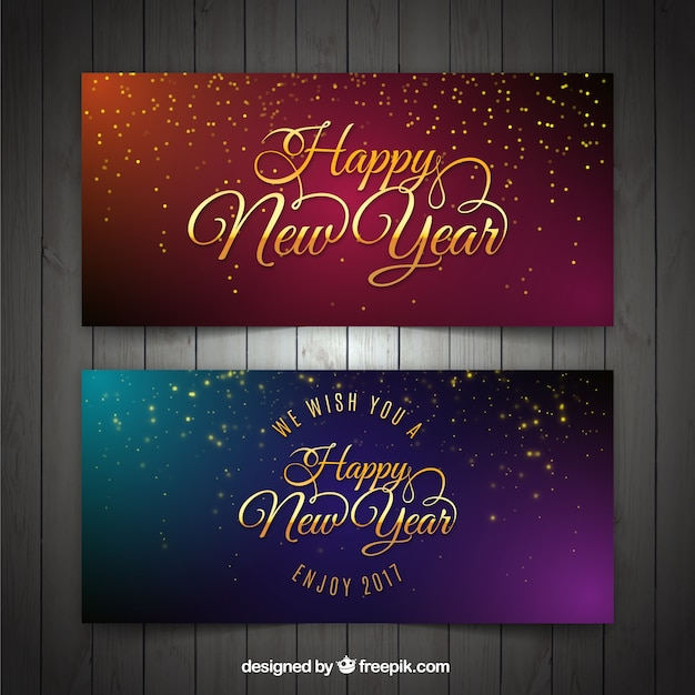 Gouden nieuwe jaar banners met kleurrijke achtergronden Gratis Vector