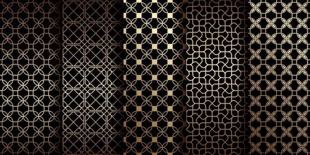 Gouden oosterse naadloze patronen met gestileerde bloemen collectie Premium Vector