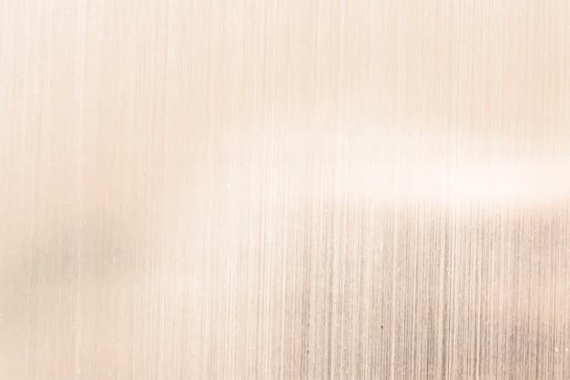 Gouden shimmery achtergrond papier Gratis Vector