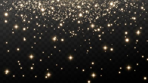 Gouden vonken en gouden sterren schitteren met een speciaal lichteffect. Premium Vector