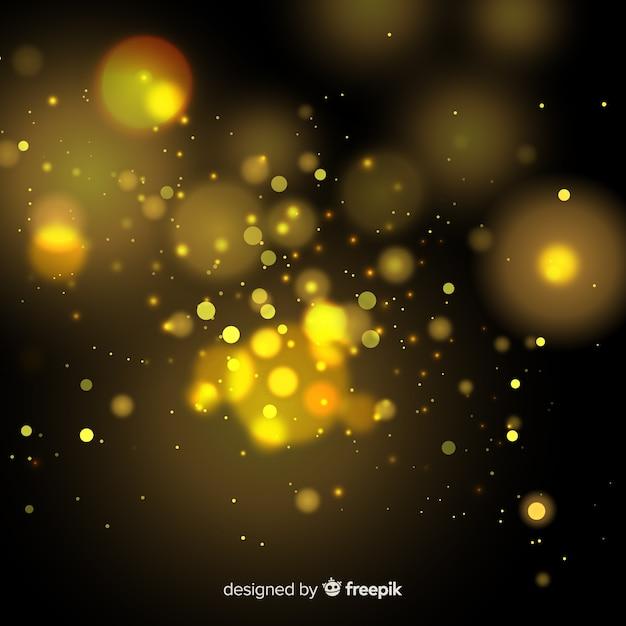 Gouden zwevend deeltjeseffect Gratis Vector