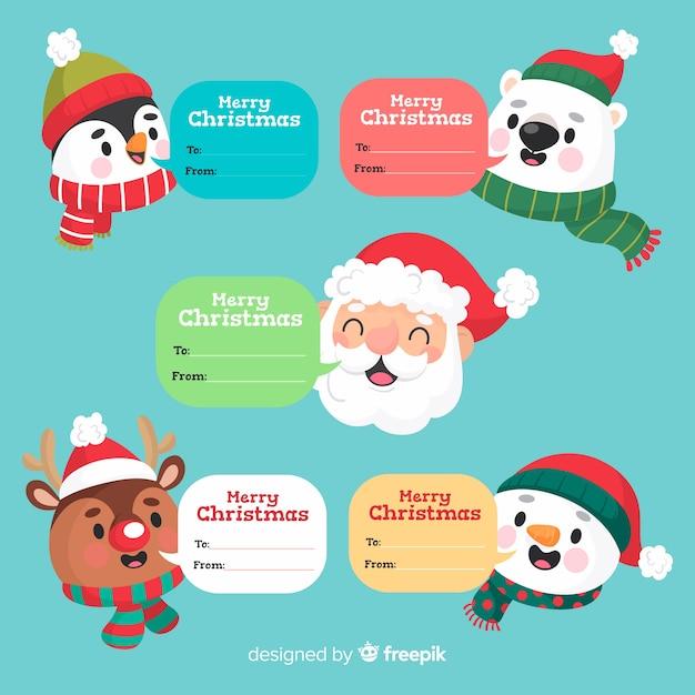 Grappige kerstmiskarakters met tekstvakken Gratis Vector