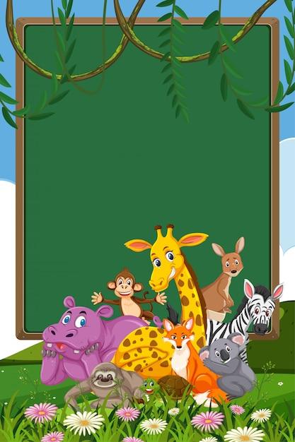 Grens sjabloonontwerp met veel wilde dieren in de achtergrond Premium Vector