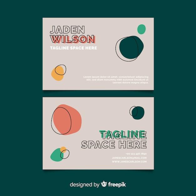 Grijs visitekaartje met ronde vormen Gratis Vector