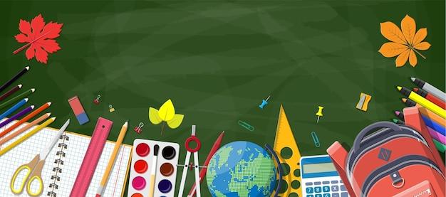 Groen bord en schoolbenodigdheden. Premium Vector