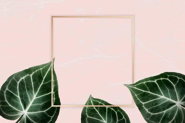 Groene bladeren op roze badge Premium Vector
