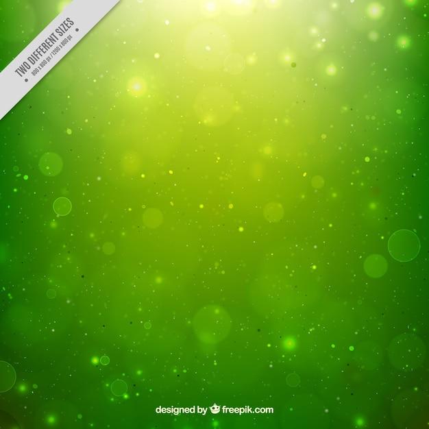 Groene bokeh achtergrond onscherp Gratis Vector