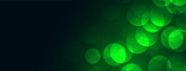 Groene bokehlichten met tekstruimte Gratis Vector