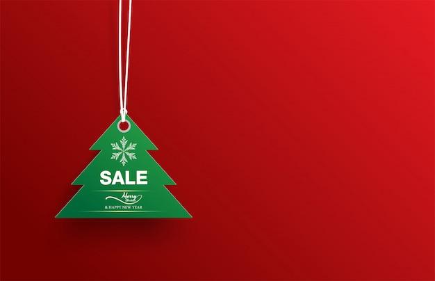 Groene de verkoop witte sneeuwvlok van de etiketkerstboom op rood Premium Vector