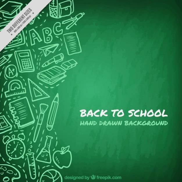 Groene schoolbord achtergrond met tekeningen Gratis Vector
