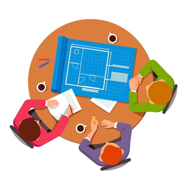 Groep architecten die bouwplannen bespreken Gratis Vector