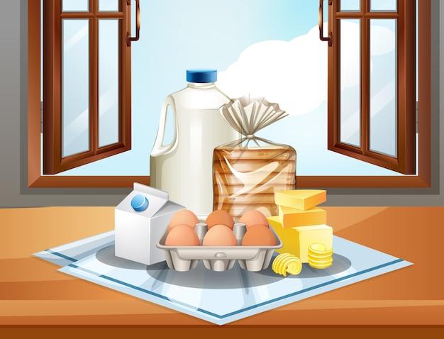 Groep bakselingrediënten zoals melkboter en eieren op vensterachtergrond Gratis Vector