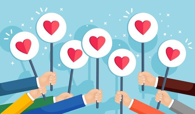 Groep bedrijfsmensen met rood hartaanplakbiljet. sociale media, netwerk Premium Vector