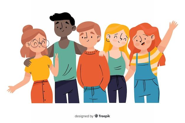 Groep jongeren die voor een foto stellen Gratis Vector