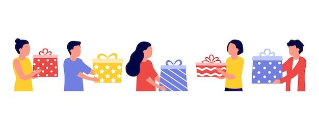Groep mensen geven geschenkdozen voor vakantie. Premium Vector