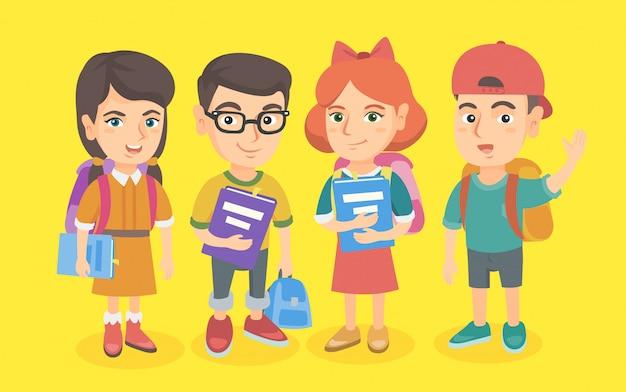 Groep scholieren met rugzakken en boeken. Premium Vector
