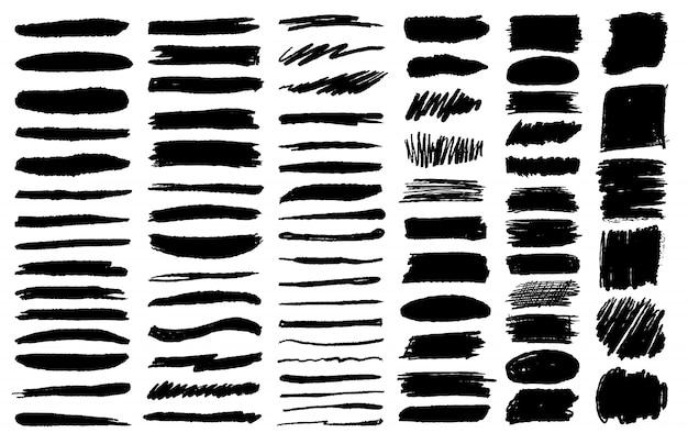 Grote reeks penseel grunge krijtslagen in zwarte inkt Premium Vector