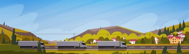 Grote semi vrachtwagenaanhangwagens die weg over de horizontale banner van het bergenlandschap drijven Premium Vector