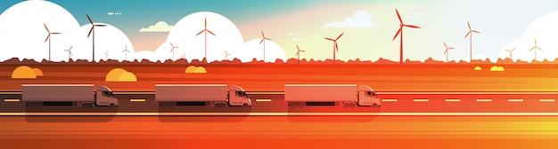Grote semi vrachtwagenaanhangwagens die weg over het landschaps horizontale banner van de aardzonsondergang drijven Premium Vector