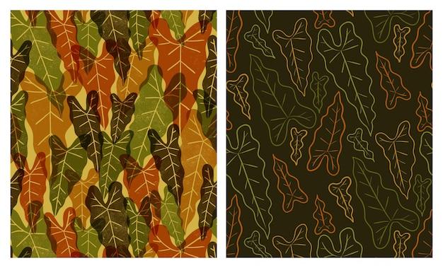 Grote tropische bladeren naadloze patronen ingesteld Premium Vector
