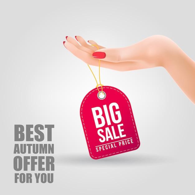 Grote verkoop, speciale prijs belettering op tag opknoping bij de hand Gratis Vector