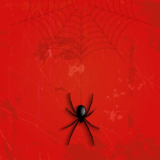 Grunge halloween achtergrond met opknoping spider Gratis Vector