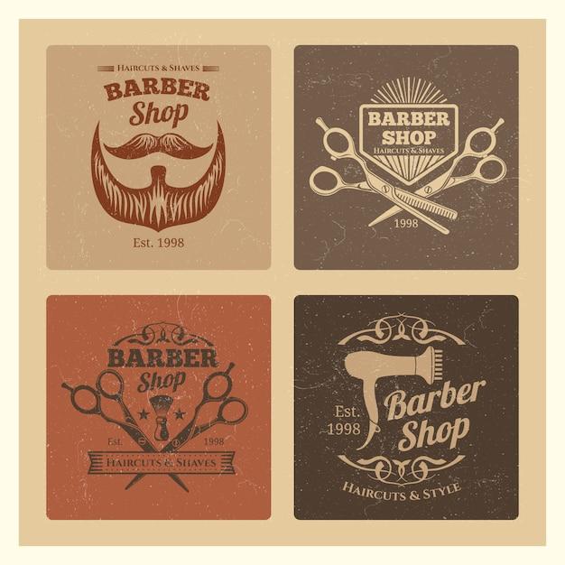 Grunge vintage kapper winkel etiketten Premium Vector