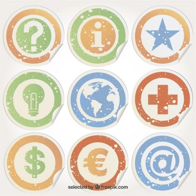 Grungy stickers met pictogrammen Gratis Vector