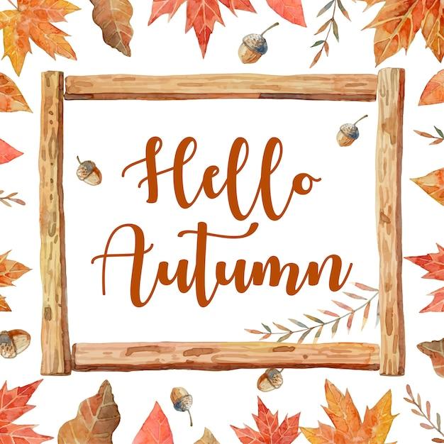 Hallo herfst in houten kozijnen en omgeven door herfstbladeren zoals esdoorn, eiken en walnoot. Premium Vector